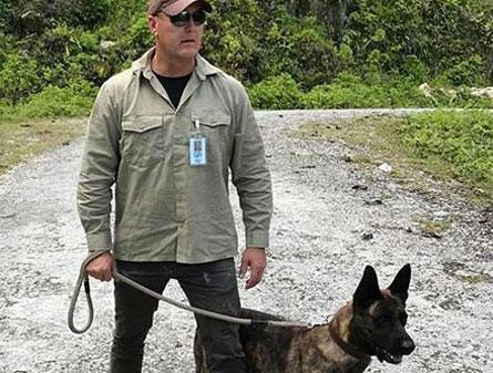 Scott in PNG with Dutch Sheperd